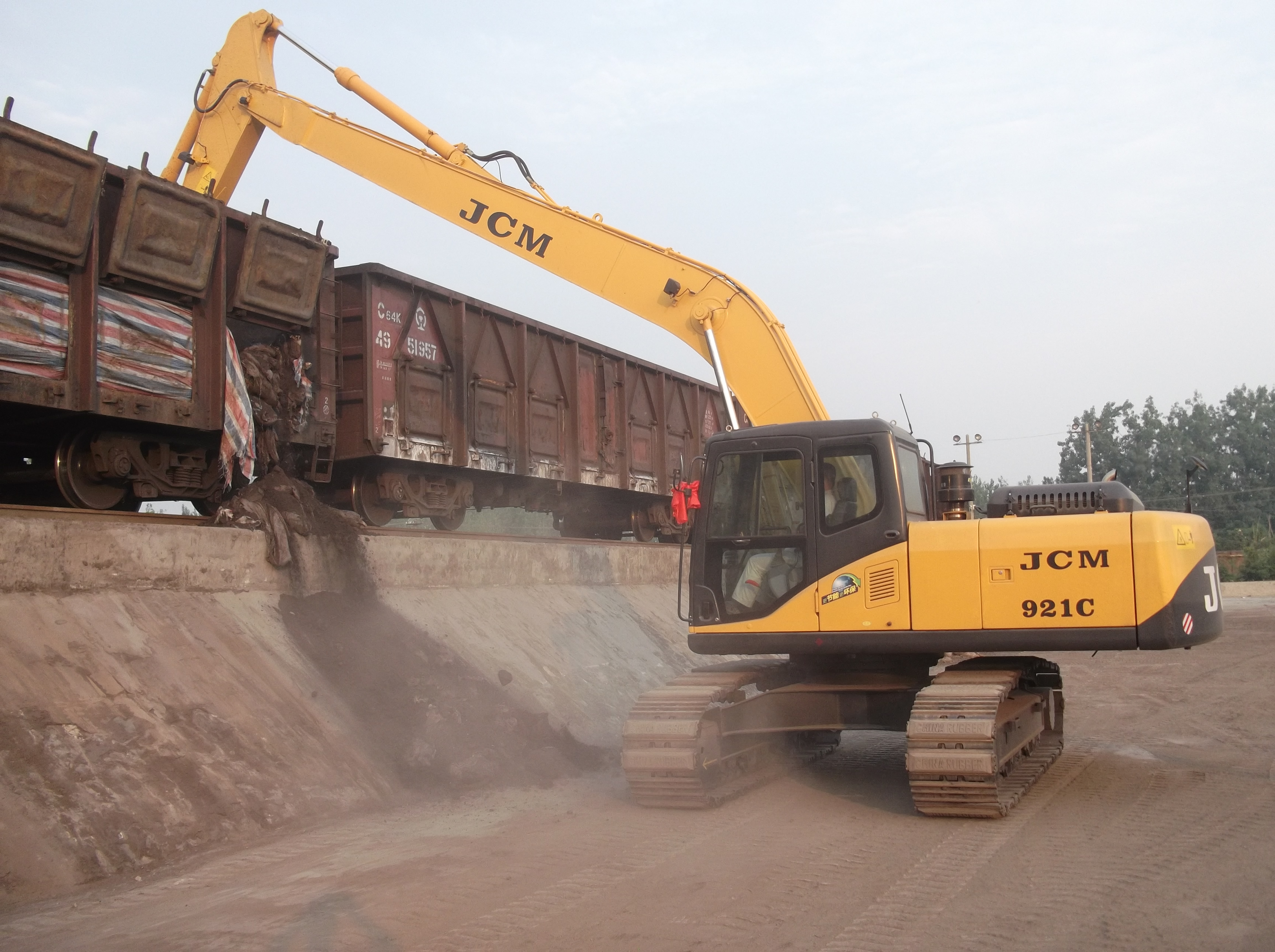JCM921 coal unloading excavator with long boom 21 tons