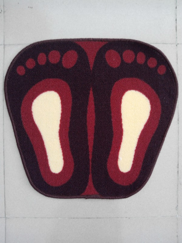 Lovely Feet Shape Floor Mat Used In Indoor Room