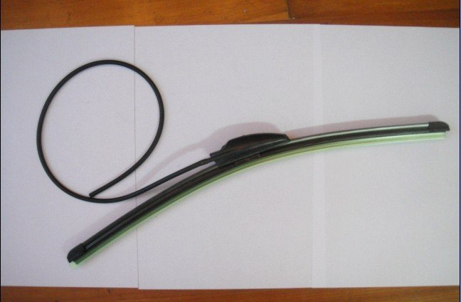 flat wiper with spray nozzle