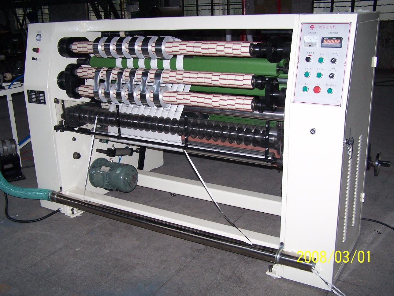 Slitting machine for adhesive tape