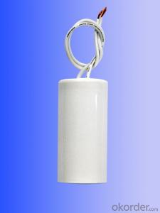 white  plastic can  with line motor running capacitors