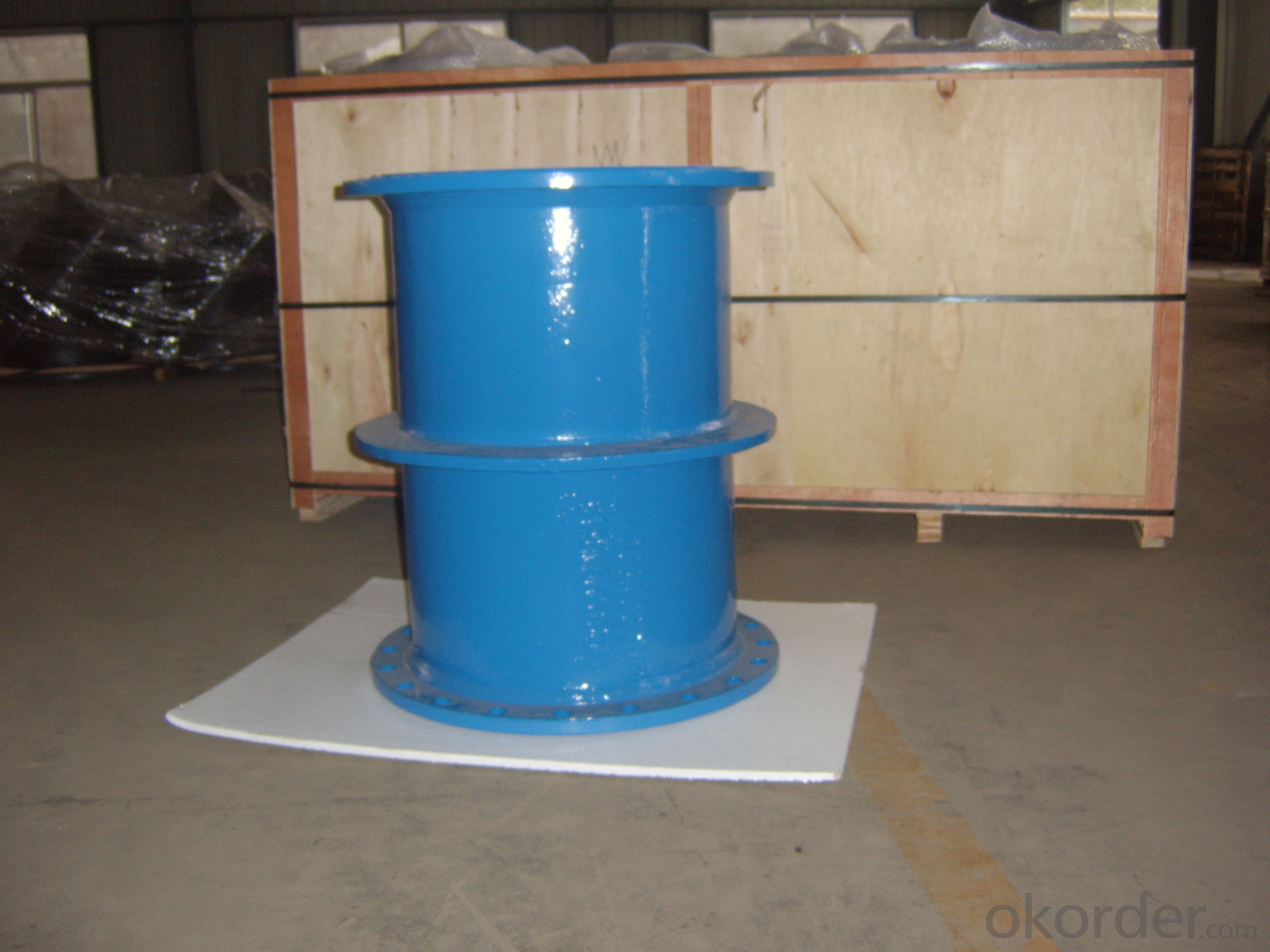 Double spigot with puddle flange fitting