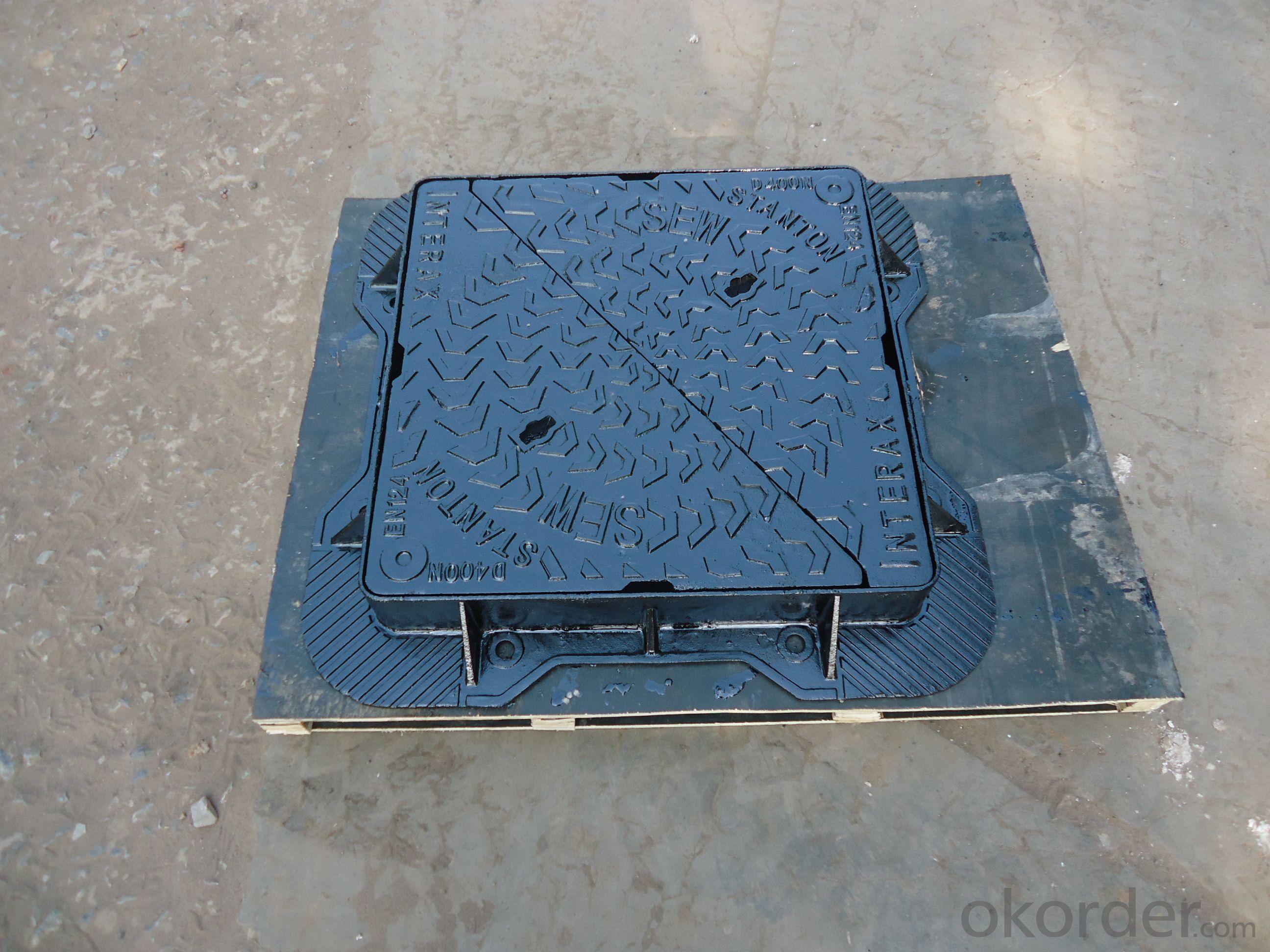 Ductile composite manhole cover