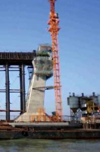 Auto-Hydraulic climbing formwork-bridge
