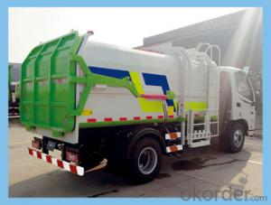 Self-discharging garbage truck, environmental equipment