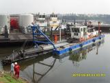What is a flour dredger used for?