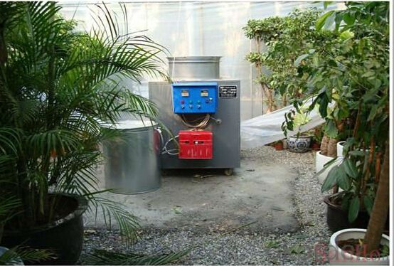 Full-auto coal-burning heating machine for poultry house