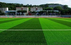 Unfaded, easily cleared artificial turf