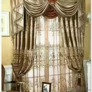 Sheer curtain with embroidered stripe pattern